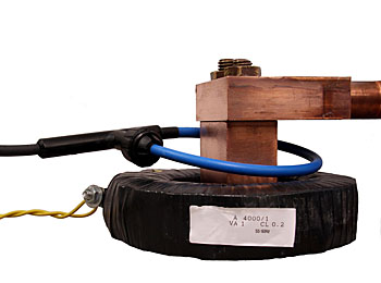 Flexible clip-around, RCT1A sense coil and a bulky fixed core metering current transformer both 4000A rated primary